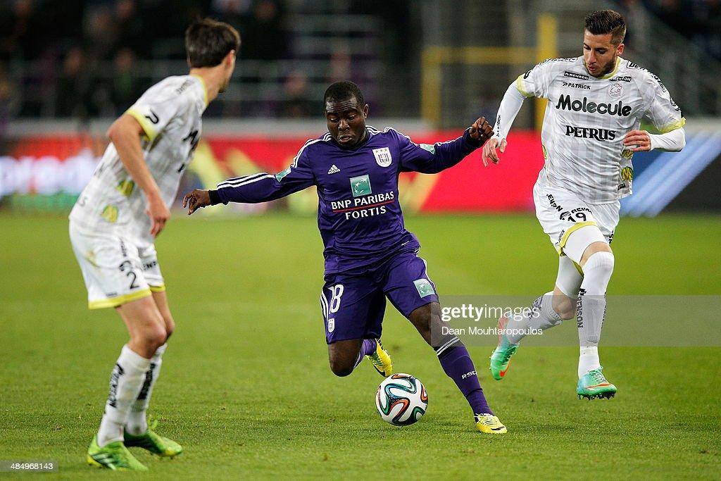 Frank Acheampong of Anderlecht runs at Raphael Caceres and Davy De Fauw of Zulte battle during the Jupiler Pro League match between RSC Anderlecht...