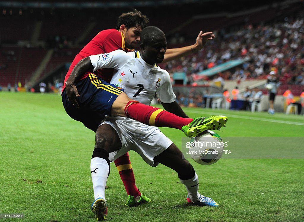 Frank Acheampong of Ghana battles with Israel Puerto of Spain during the FIFA U-20 World Cup Group A match between Spain and Ghana at the Ali Sami Yen Arena on June 24, 2013 in Istanbul, Turkey.