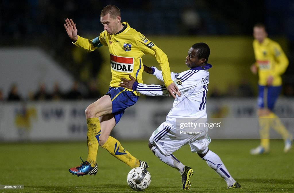 Frank Acheampong of RSC Anderlecht battles for the ball with Geudens Kevin of KVC Westerlo during the Cofidis Cup 1/8 final match between KVC...