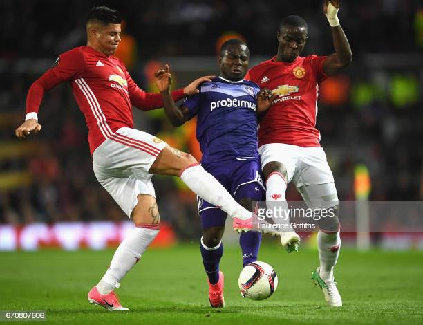 Frank Acheampong of RSC Anderlecht battles with Marcos Rojo and Eric Bailly of Manchester United during the UEFA Europa League quarter final second...