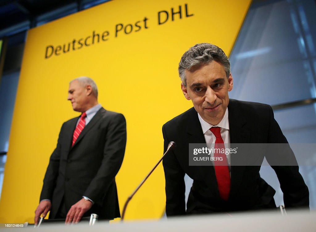 Frank Appel, CEO of Deutsche Post DHL (R) and CFO Lawrence Rosen (L) arrive for the annual results press conference of the German logistics giant on March 5, 2013 in Bonn, western Germany. Deutsche Post announced on March 5, 2013 strong annual results, driven by the dynamism of its divisions express, freight and logistics DHL, fully benefiting from the growth in emerging countries.
