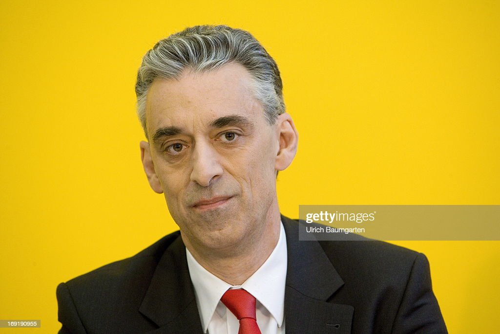 Frank Appel, CEO of the Deutsche Post DHL, addresses a press conference as Deutsche Post launch carbon-neutral mail delivery with electric commercial vehicles on May 21, 2013 in Bonn, Germany. Initially 79 vehicles will be put into service in Bonn and the surrounding area for delivery.