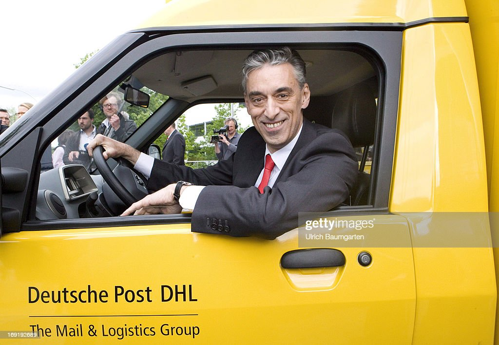 Frank Appel, CEO of the Deutsche Post DHL, sits in a carbon-neutral mail delivery vehicle on May 21, 2013 in Bonn, Germany. Initially 79 vehicles will be put into service in Bonn and the surrounding area for delivery.