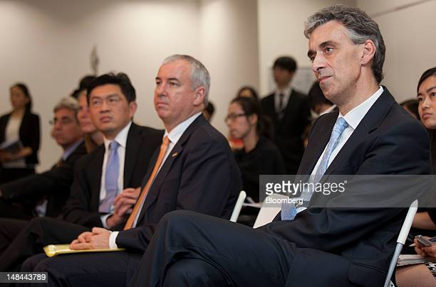 Frank Appel chief executive officer of Deutsche Post AG right Paul Graham chief executive officer for Asia Pacific DHL Supply Chain second right and...