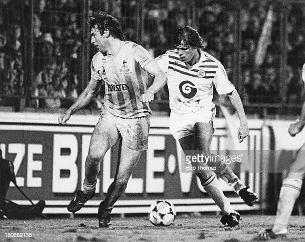 Frank Arnesen of RSC Anderlecht takes on Tony Galvin of Tottenham Hotspur during the UEFA Cup final first leg at Constant Vanden Stock Stadium...