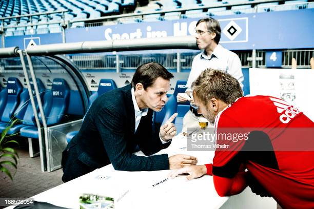 Frank Arnesen with the coach Thorsten Fink at the Imtech Arena in Hamburg Germany 3rd August 2012 Frank Arnesen is a former Danish football player...