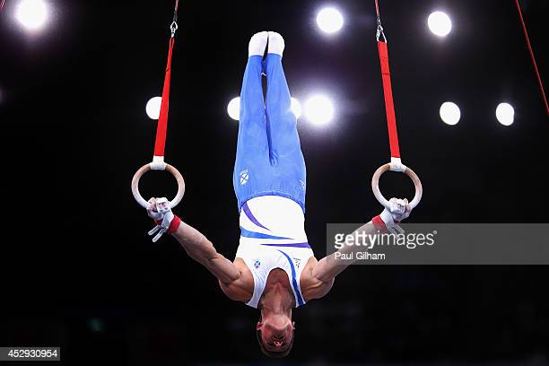 Frank Baines of Scotland competes in the Parallel Bars during the Men's AllAround Final at SECC Precinct during day seven of the Glasgow 2014...