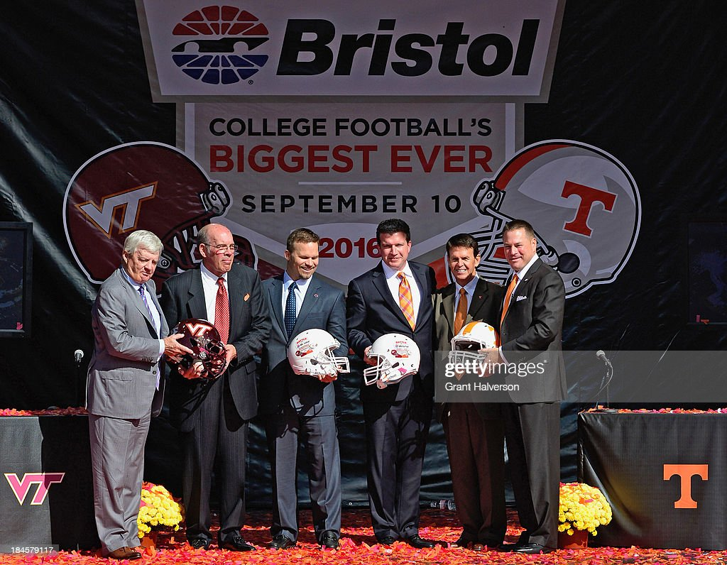 <a gi-track='captionPersonalityLinkClicked' href=/galleries/search?phrase=Frank+Beamer&family=editorial&specificpeople=234759 ng-click='$event.stopPropagation()'>Frank Beamer</a>, Virginia Tech head coach, Jim Weaver, Virginia Tech athletic director director, Marcus Smith, president and COO of Speedway Motorsports, Jerry Caldwell, general manager of Bristol Motor Speedway, Dave Hart, Tennessee vice chancellor and director of athletics, and Butch Jones, Tennessee head coach pose for a photo at Bristol Motor Speedway on October 14, 2013 in Bristol, Tennessee. Bristol Motor Speedway plans to transform the legendary Speedway into the world's largest football stadium for the inaugural Battle at Bristol, to be held on Saturday, September 10, 2016. The event will feature a game between the Virginia Tech Hokies and Tennessee Volunteers and is projected to set the NCAA record for highest single-game attendance.