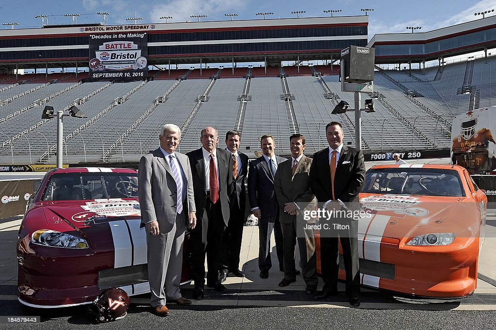 <a gi-track='captionPersonalityLinkClicked' href=/galleries/search?phrase=Frank+Beamer&family=editorial&specificpeople=234759 ng-click='$event.stopPropagation()'>Frank Beamer</a>, Virginia Tech Head Coach, Jim Weaver, Virginia Tech Athletic Director, Jerry Caldwell, General Manager Bristol Motor Speedway, Marcus Smith, President/COO Speedway Motorsports, Dave Hart, Tennessee Vice Chancellor/Athletic Director, and Butch Jones, Tennessee Head Coach, pose for a photo at Bristol Motor Speedway on October 14, 2013 in Bristol, Tennessee. Bristol Motor Speedway plans to transform the legendary Speedway into the world's largest football stadium for the inaugural Battle at Bristol, to be held on Saturday, September 10, 2016. The event will feature a game between the Virginia Tech Hokies and Tennessee Volunteers and is projected to set the NCAA record for highest single-game attendance.