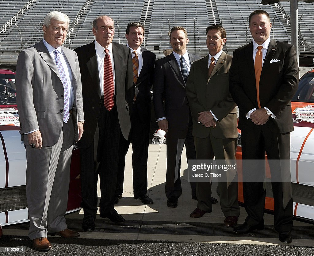 Frank Beamer, Virginia Tech Head Coach, Jim Weaver, Virginia Tech Athletic Director, Jerry Caldwell, General Manager Bristol Motor Speedway, Marcus Smith, President/COO Speedway Motorsports, Dave Hart, Tennessee Vice Chancellor/Athletic Director, and Butch Jones, Tennessee Head Coach, pose for a photo opportunity at Bristol Motor Speedway on October 14, 2013 in Bristol, Tennessee. Bristol Motor Speedway plans to transform the legendary Speedway into the world's largest football stadium for the inaugural Battle at Bristol, to be held on Saturday, September 10, 2016. The event will feature a game between the Virginia Tech Hokies and Tennessee Volunteers and is projected to set the NCAA record for highest single-game attendance.