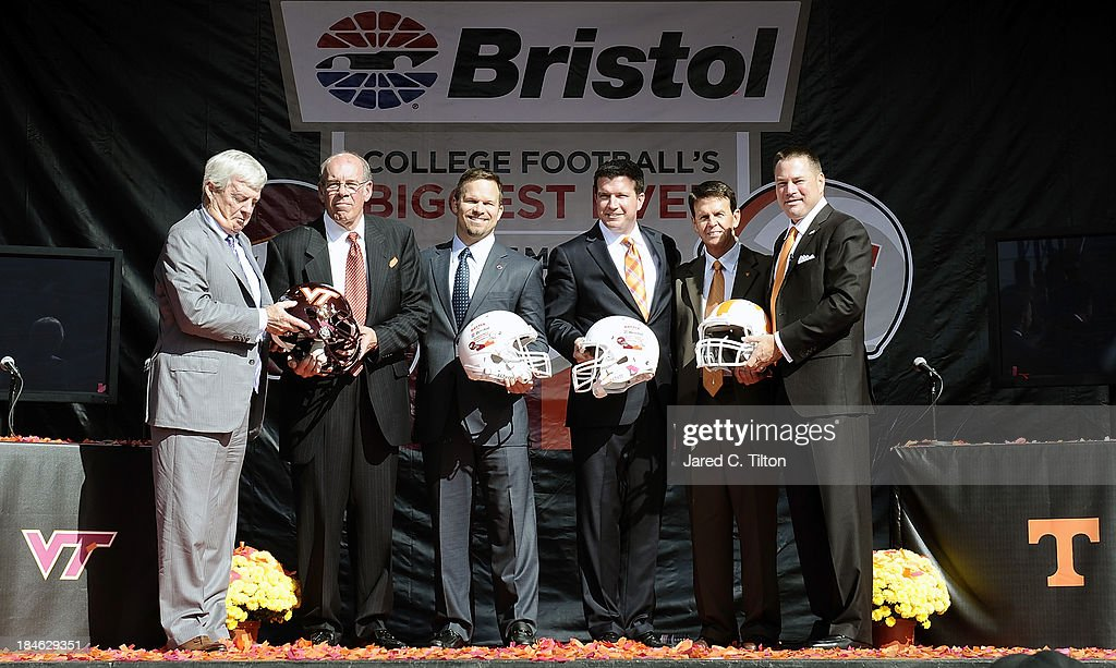 Frank Beamer, Virginia Tech Head Coach, Jim Weaver, Virginia Tech Athletic Director, Marcus Smith, President/COO Speedway Motorsports, Jerry Caldwell, General Manager Bristol Motor Speedway, Dave Hart, Tennessee Vice Chancellor/Athletic Director, and Butch Jones, Tennessee Head Coach, pose for a photo opportunity at Bristol Motor Speedway on October 14, 2013 in Bristol, Tennessee. Bristol Motor Speedway plans to transform the legendary Speedway into the world's largest football stadium for the inaugural Battle at Bristol, College Football's Biggest EVER game to be held on Saturday, September 10, 2016. The event will feature a border battle between the Virginia Tech Hokies and Tennessee Volunteers and is projected to set the NCAA record for highest single-game attendance.