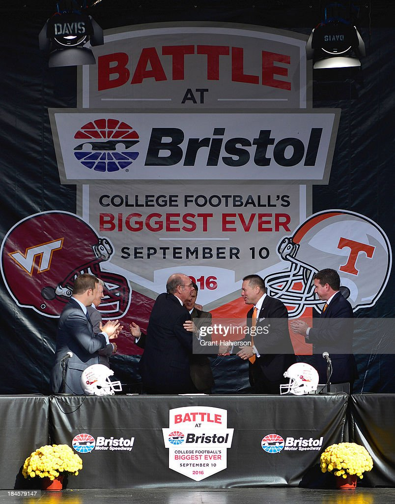 Frank Beamer, Virginia Tech head coach, Marcus Smith, president and COO of Speedway Motorsports, Jim Weaver, Virginia Tech athletic director director, Dave Hart, Tennessee vice chancellor and director of athletics, Butch Jones, Tennessee head coach, and Jerry Caldwell, general manager of Bristol Motor Speedway, sign the official contracts during a press conference at Bristol Motor Speedway on October 14, 2013 in Bristol, Tennessee. Bristol Motor Speedway plans to transform the legendary Speedway into the world's largest football stadium for the inaugural Battle at Bristol, to be held on Saturday, September 10, 2016. The event will feature a game between the Virginia Tech Hokies and Tennessee Volunteers and is projected to set the NCAA record for highest single-game attendance.