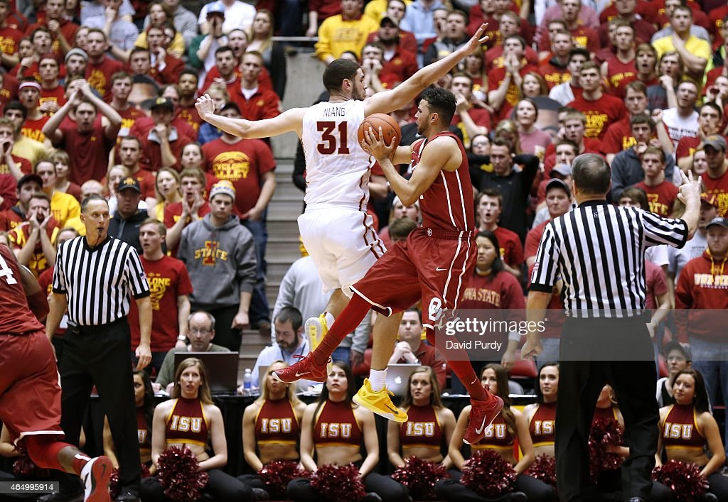 Frank Booker #1 of the Oklahoma Sooners is fouled by <a gi-track='captionPersonalityLinkClicked' href=/galleries/search?phrase=Georges+Niang&family=editorial&specificpeople=10061173 ng-click='$event.stopPropagation()'>Georges Niang</a> #31 of the Iowa State Cyclones as he takes a three point shot in the second half of play at Hilton Coliseum on March 2, 2015 in Ames, Iowa. Iowa State defeated Oklahoma 77-70.