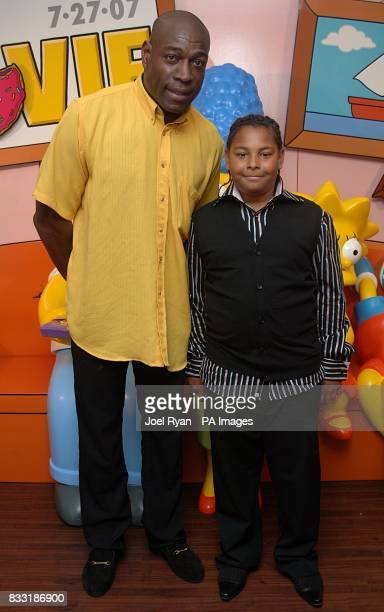 Frank Bruno and his son Franklin arrive for the UK Premiere of The Simpsons Movie at the Vue Cinema The O2 Peninsula Square London