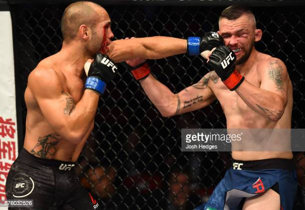 Frank Camacho of Guam punches Damien Brown of Austrailia in their lightweight bout during the UFC Fight Night event inside the Qudos Bank Arena on...