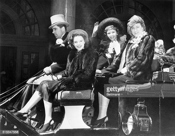 Frank Carroll sportsman drives the traditional Easter coach down Fifth Avenue accompanied by Judy Garland screen and radio singing star Mary Martin...