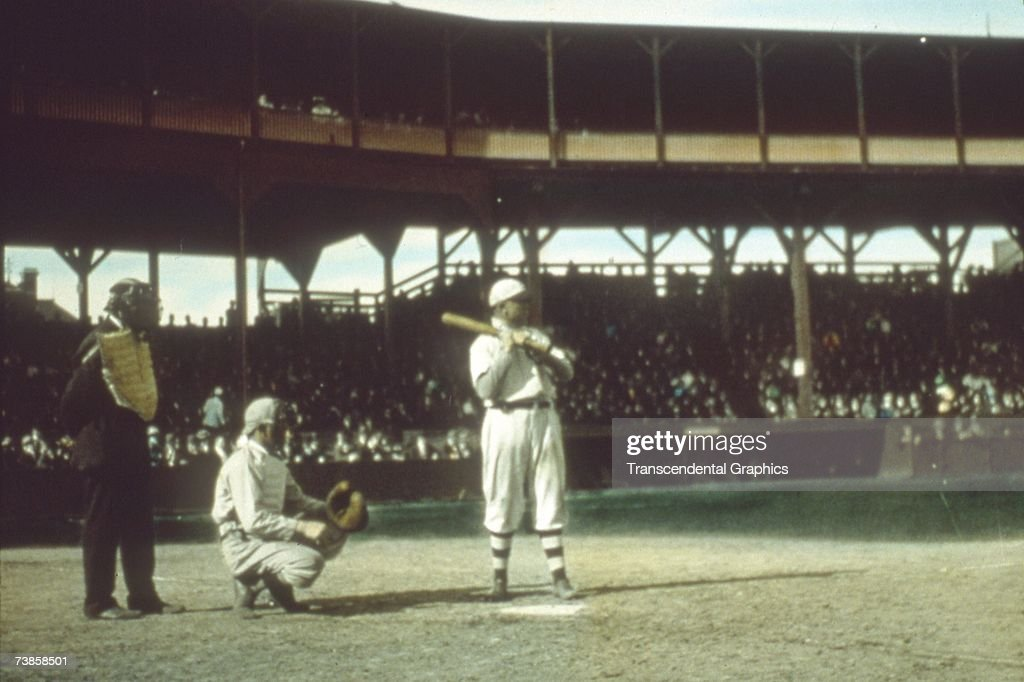 CHICAGO - OCTOBER, 1907. Frank Chance, first baseman of the Chicago Cubs, awaits a pitch in the 1907 Worlds Series in October in Chicago's West Side Grounds, as the Tigers' Fred Payne is catching. The photo is a glass slide of the 1907 Series, designed to be projected between movies in a cinema one hundred years ago.