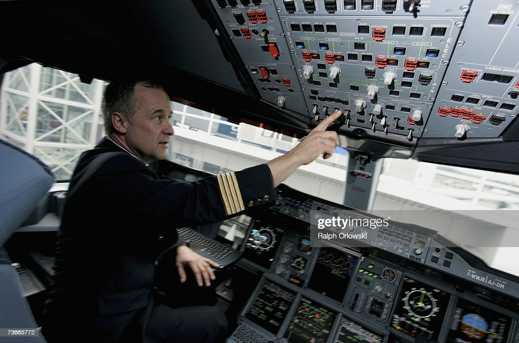 Frank Chapman, experimental test pilot of Airbus, sits in a cockpit of an Airbus A380 parked at Frankfurt airport March 22, 2007 in Frankfurt, Germany. The 555-seat double-decker A380 returned from a test flight of Lufthansa and Airbus from JFK International Airport to test airport function and compatibility of the world's largest passenger aircraft.