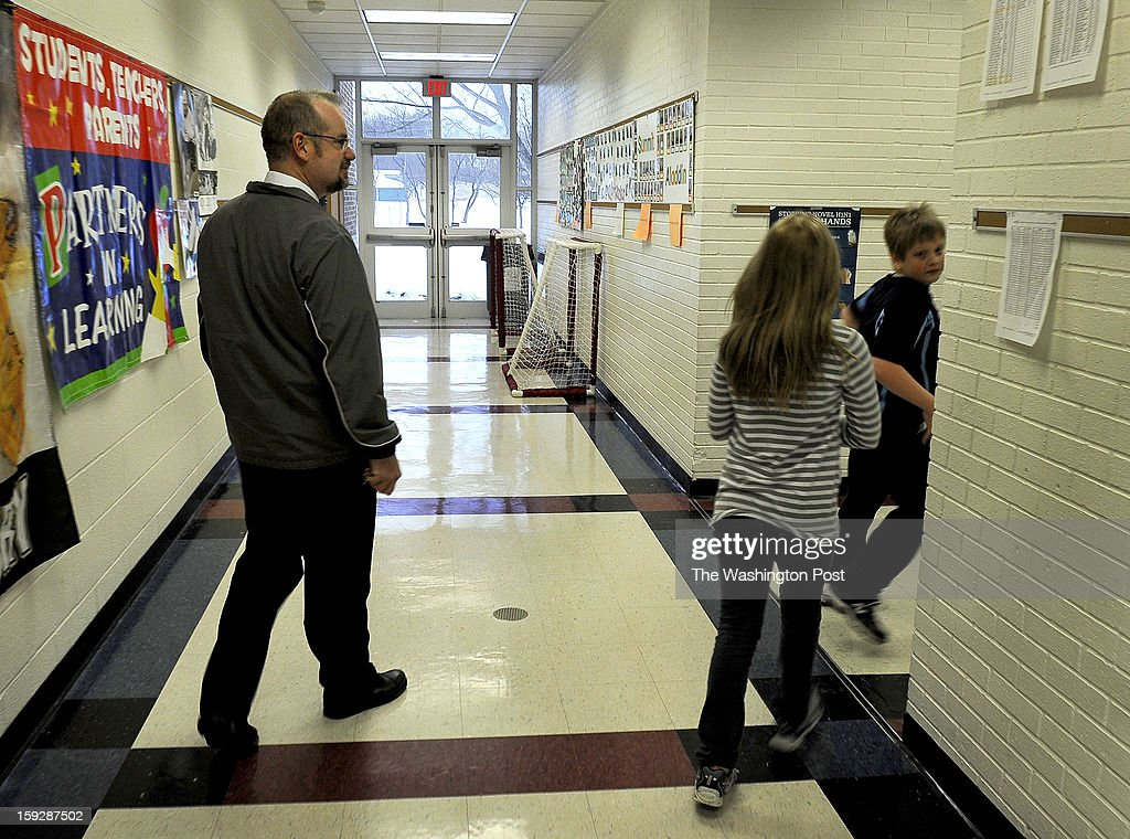 Frank Cichra patrols the hallway at Summit E.S. He's a retired trooper who carries a gun, but not in plain sight so as to not cause concern among the students at Summit E.S. Schools in Butler, PA are using retired state troopers to guard their schools in the wake of the Newtown, CT shootings. Photo by Michael S. Williamson/The Washington Post via Getty Images