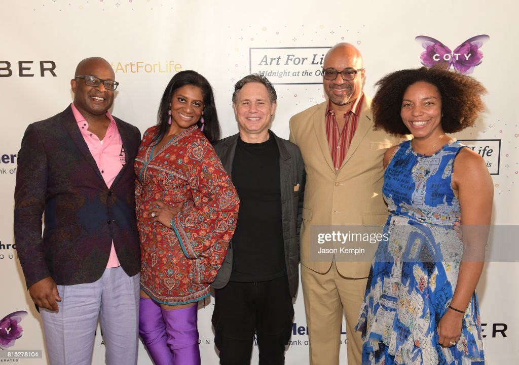 Frank Cooper III and Nina Cooper and Jason Binn and guests attend 2017 Rush Philanthropic Arts Foundation Art For Life Benefit at Fairview Farms on July 15, 2017 in Water Mill, New York.