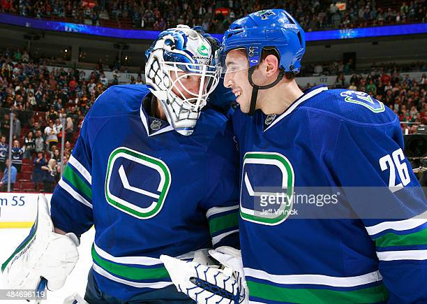 Frank Corrado and Jacob Markstrom of the Vancouver Canucks celebrate a victory over the Calgary Flames in their NHL game at Rogers Arena April 13...