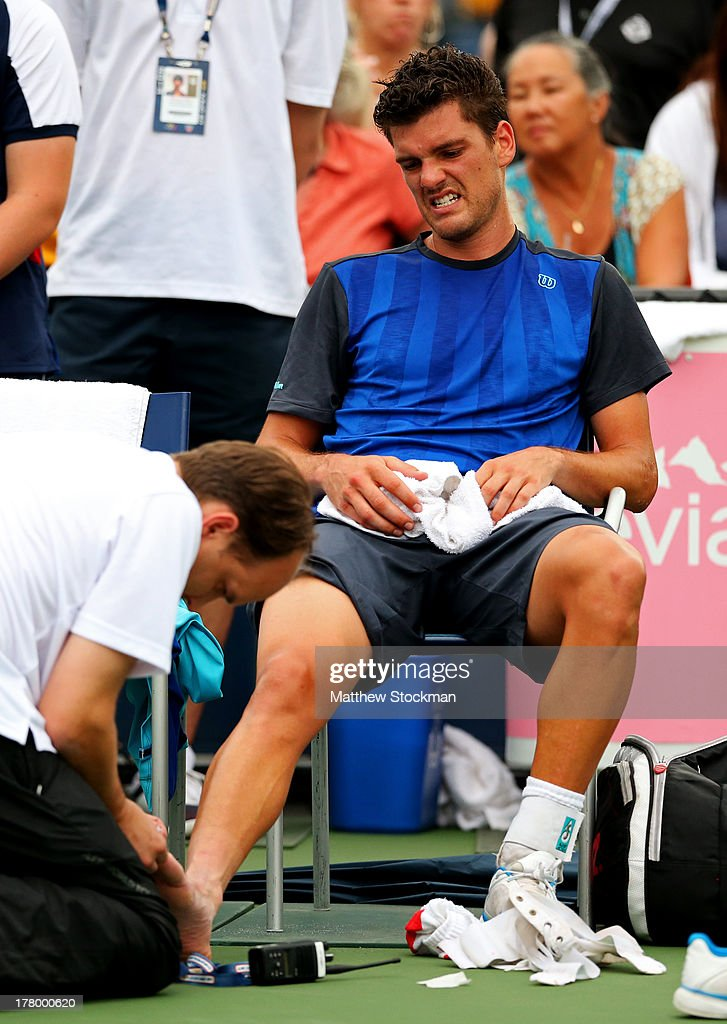 Frank Dancevic of Canada 7receives treatment for an injury during a break in his men's singles first round match against Robin Haase of Netherlands...