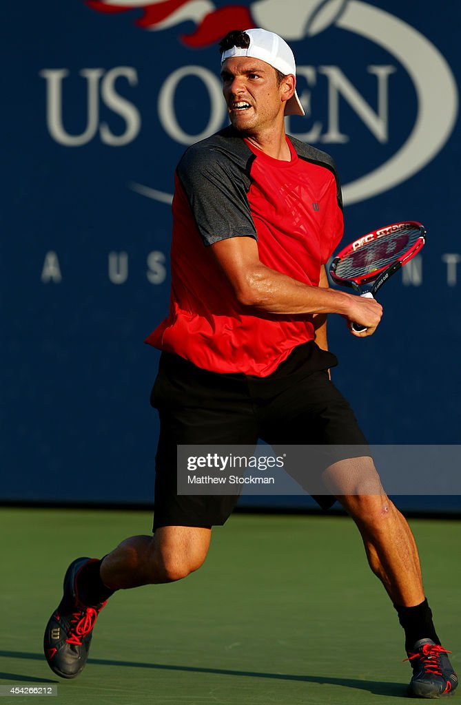 Frank Dancevic of Canada against Joao Sousa of Portugal during their men's singles first round match on Day Three of the 2014 US Open at the USTA...