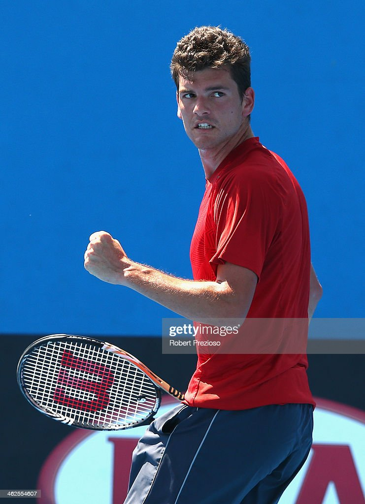 Frank Dancevic of Canada celebrates a point in his first round match against Benoit Paire of France during day two of the 2014 Australian Open at...