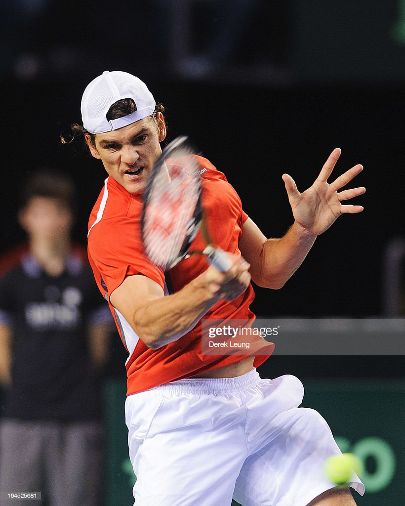 Frank Dancevic of Canada hits a return to Albert Ramos of Spain during their singles match on day three of the 2013 Davis Cup on February 3 2013 at...