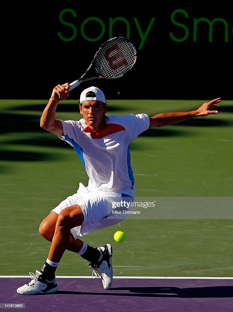 Frank Dancevic of Canada in action against Mardy Fish during Day 6 of the Sony Ericsson Open at Crandon Park Tennis Center on March 24 2012 in Key...