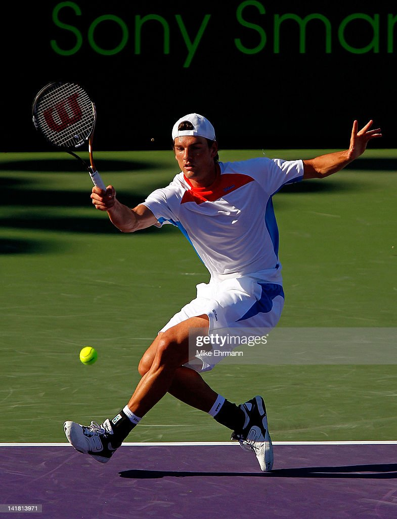 <a gi-track='captionPersonalityLinkClicked' href=/galleries/search?phrase=Frank+Dancevic&family=editorial&specificpeople=580662 ng-click='$event.stopPropagation()'>Frank Dancevic</a> of Canada in action against Mardy Fish during Day 6 of the Sony Ericsson Open at Crandon Park Tennis Center on March 24, 2012 in Key Biscayne, Florida.