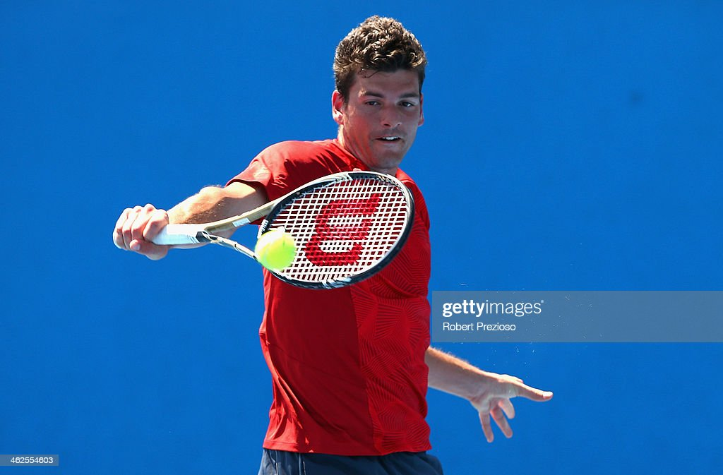 Frank Dancevic of Canada plays a backhand in his first round match against Benoit Paire of France during day two of the 2014 Australian Open at...