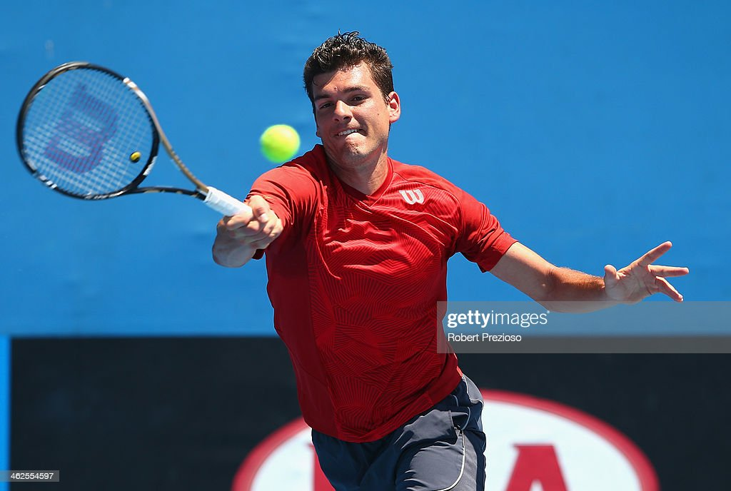 Frank Dancevic of Canada plays a forehand in his first round match against Benoit Paire of France during day two of the 2014 Australian Open at...