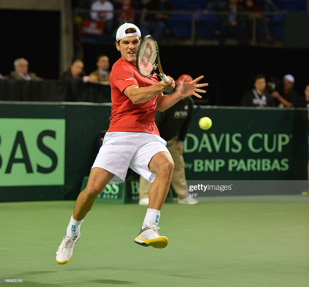 Frank Dancevic of Canada plays against Marcel Granollers of Spain during a Davis Cup World Group 2nd Singles Rubber, at the Doug Mitchell Thunderbird Sports Centre, in Vancouver BC, on February 1, 2013. AFP PHOTO/Don MacKinnon