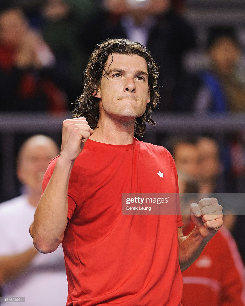 Frank Dancevic of Canada reacts after defeating Marcel Granollers of Spain on day one of the 2013 Davis Cup on February 1 2013 at UBC Thunderbird...