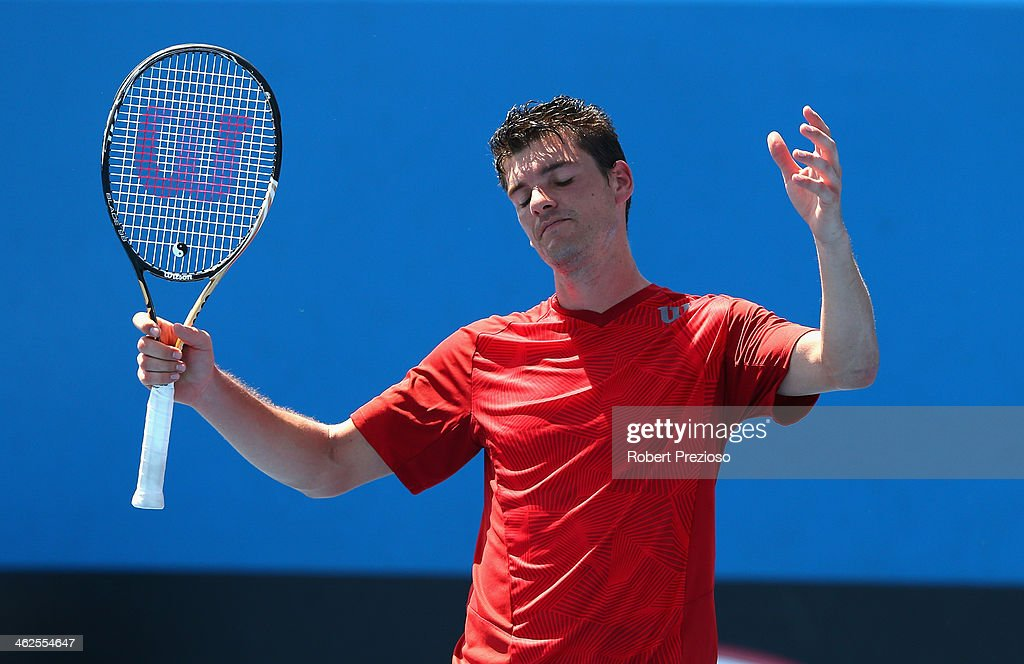 <a gi-track='captionPersonalityLinkClicked' href=/galleries/search?phrase=Frank+Dancevic&family=editorial&specificpeople=580662 ng-click='$event.stopPropagation()'>Frank Dancevic</a> of Canada reacts in his first round match against Benoit Paire of France during day two of the 2014 Australian Open at Melbourne Park on January 14, 2014 in Melbourne, Australia.