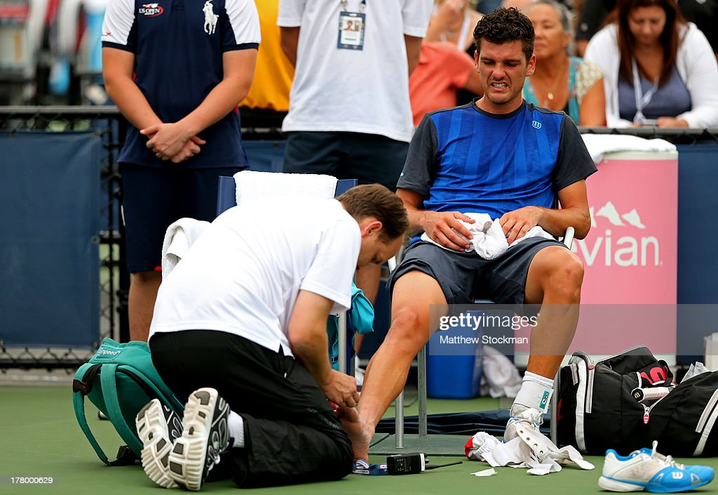 Frank Dancevic of Canada receives treatment for an injury during a break in his men's singles first round match against Robin Haase of Netherlands on...
