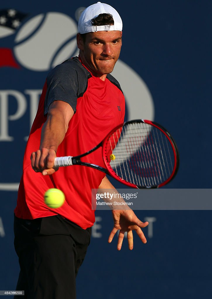 Frank Dancevic of Canada returns a shot against Joao Sousa of Portugal during their men's singles first round match on Day Three of the 2014 US Open...