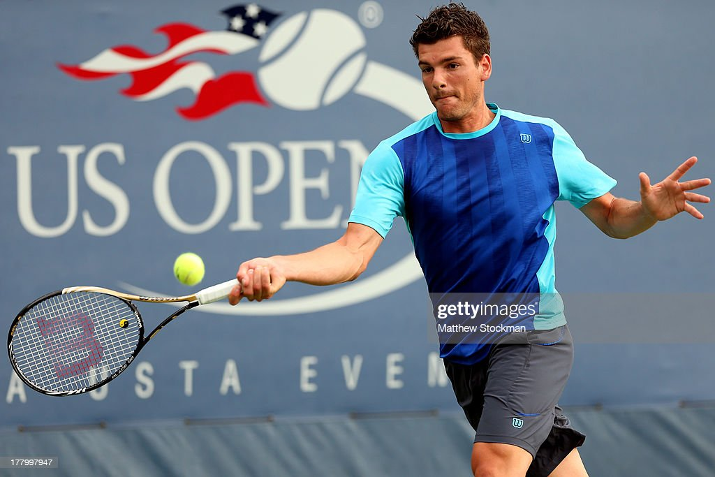 Frank Dancevic of Canada returns a shot against Robin Haase of the Netherlands during their first round men's singles match on Day One of the 2013 US...