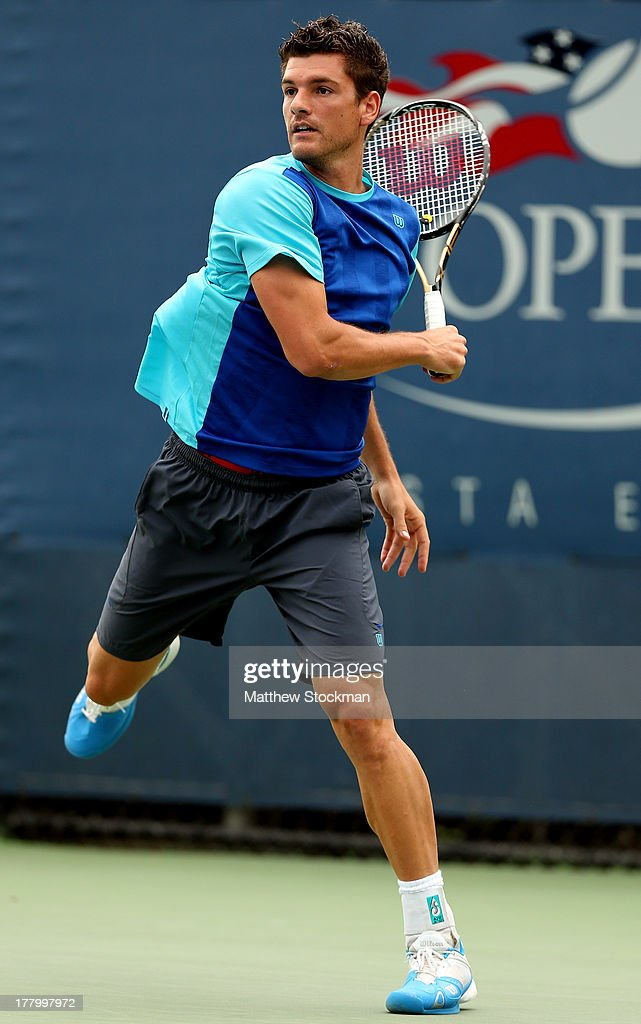 <a gi-track='captionPersonalityLinkClicked' href=/galleries/search?phrase=Frank+Dancevic&family=editorial&specificpeople=580662 ng-click='$event.stopPropagation()'>Frank Dancevic</a> of Canada returns a shot against Robin Haase of the Netherlands during their first round men's singles match on Day One of the 2013 US Open at USTA Billie Jean King National Tennis Center on August 26, 2013 in the Flushing neigborhood of the Queens borough of New York City.