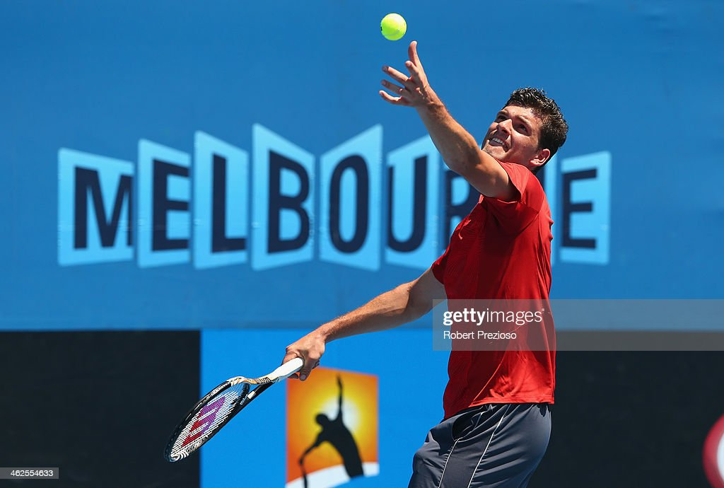Frank Dancevic of Canada serves in his first round match against Benoit Paire of France during day two of the 2014 Australian Open at Melbourne Park...