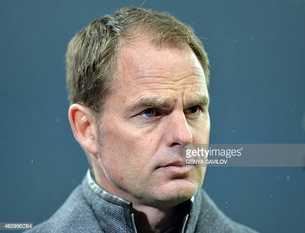 Frank de Boer head coach of Ajax Amsterdam watches from the dugout during the Europa League Round of 16 match between Dnipro Dnipropetrovsk and Ajax...