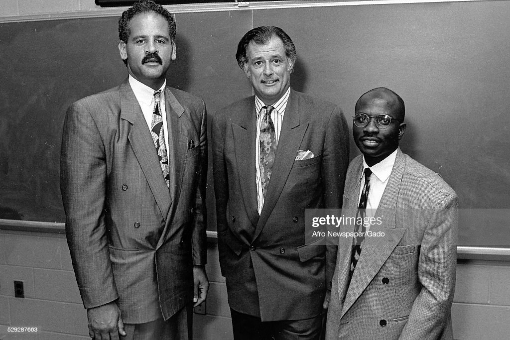Frank Deford and small group of people, 1988, Original Caption Reads: 'From Left To Right, Stedman Graham-Managing Partner-Chicago, Graham Williams Group, Frank Deford--Publisher '.