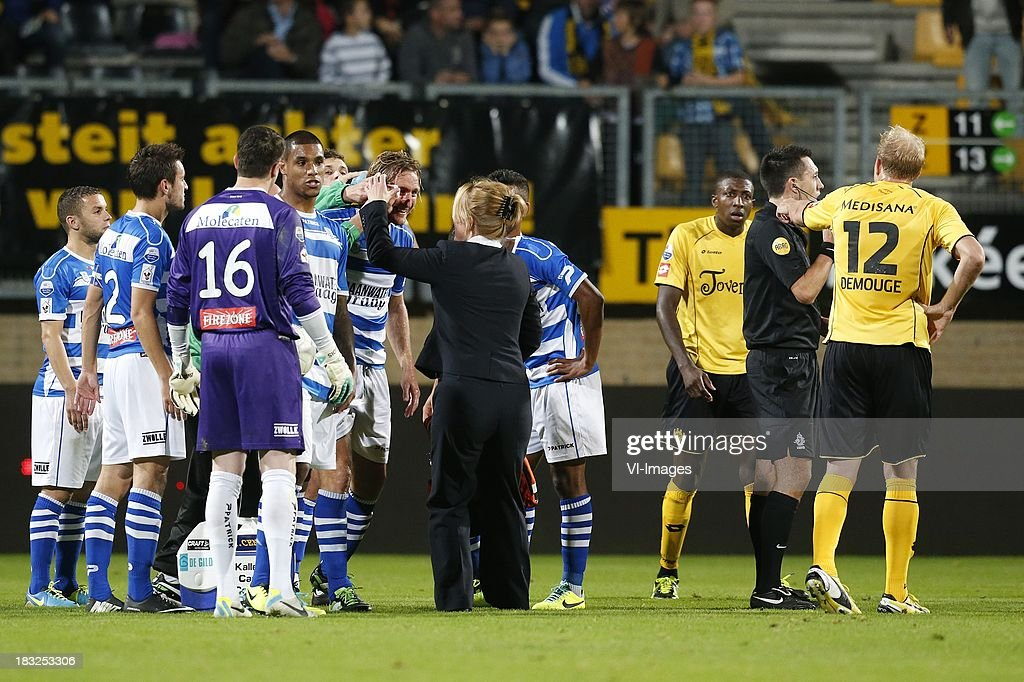 Frank Demouge of Roda JC (R), Referee Dennis Higler (2R), Joost Broerse of PEC Zwolle (CL) during the Dutch Eredivisie match between Roda JC Kerkrade and PEC Zwolle at the Parkstad Limburg on Oktober 5, 2013 in Kerkrade, The Netherlands