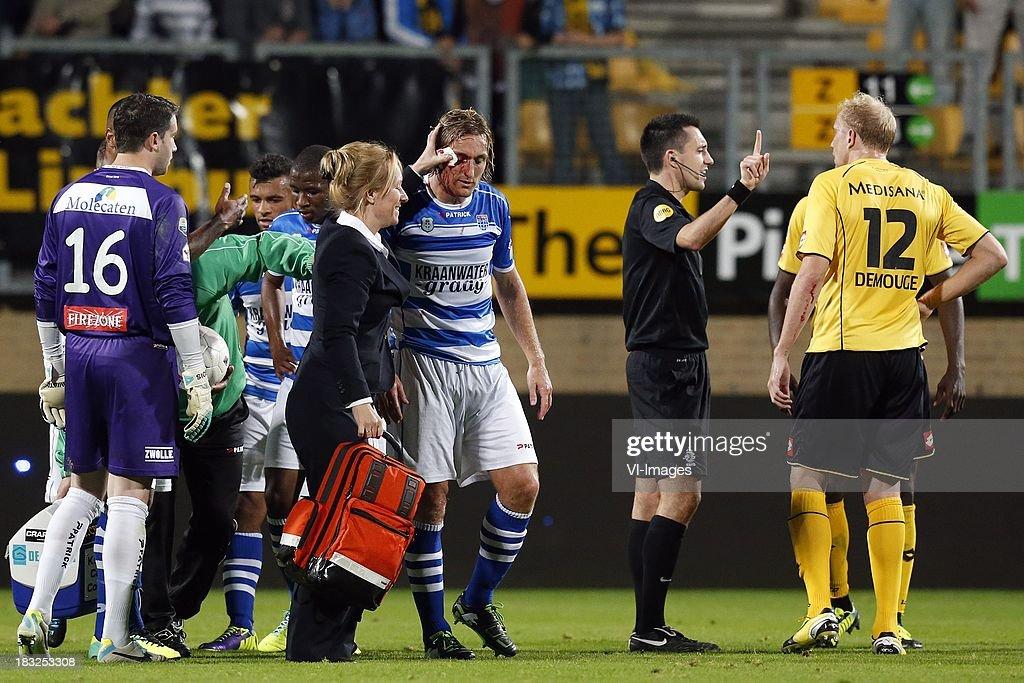 Frank Demouge of Roda JC (R), Referee Dennis Higler (2R), Joost Broerse of PEC Zwolle (C) during the Dutch Eredivisie match between Roda JC Kerkrade and PEC Zwolle at the Parkstad Limburg on Oktober 5, 2013 in Kerkrade, The Netherlands