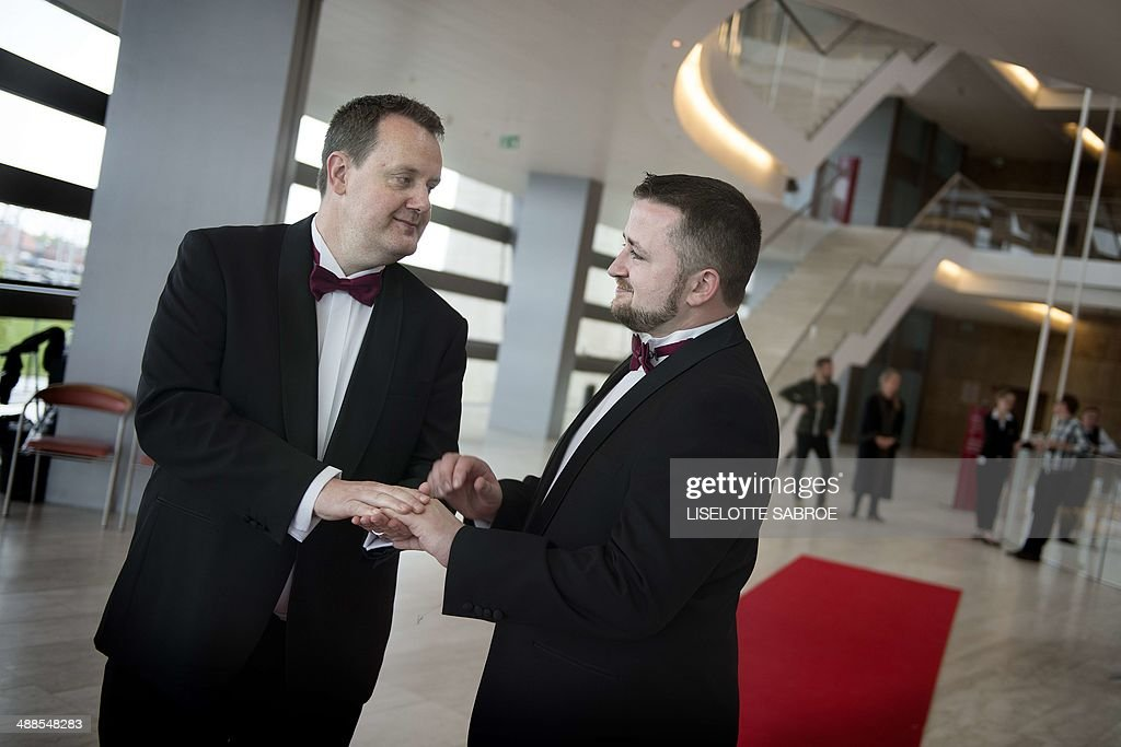 Frank Dermody and Jonathan Neville from Ireland attend their wedding ceremony on May 7, 2014 in Copenhagen on the sidelines of the Eurovision Song Contest. In Ireland same-sex marriage is not permitted as it is in Denmark. On Wednesday, May 7, 2014 same-sex and hetero-sex couples from Denmark and abroad are married in the Copenhagen Opera House close to Eurovision Island. The event is one of several wedding events taking place in Copenhagen during the Eurovision Song Contest and is organized by the City of Copenhagen. The capital of Denmark also marks with these events that in 2014 it is 25 years ago, that Denmark as the first country in the world legalized same-sex marriage. AFP PHOTO / Scanpix Denmark / LISELOTTE SABROE /DENMARK OUT