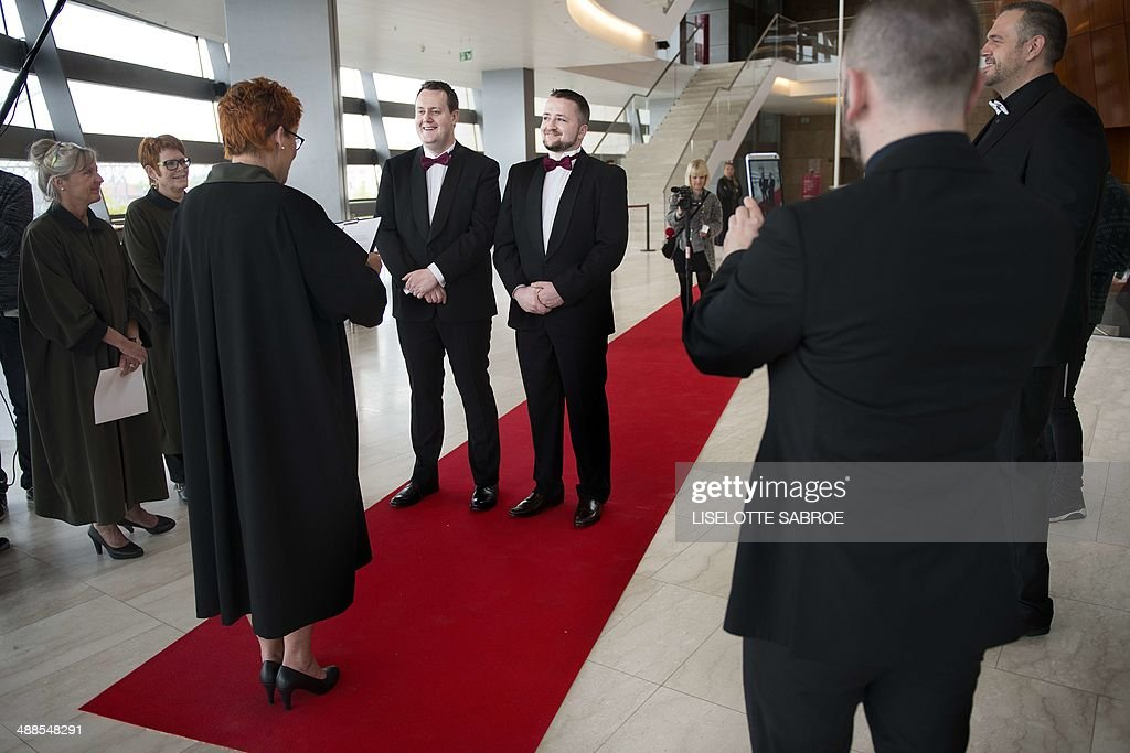 Frank Dermody and Jonathan Neville from Ireland get married at the Opera House on May 7, 2014 in Copenhagen on the sidelines of the Eurovision Song Contest. In Ireland same-sex marriage is not permitted as it is in Denmark. On Wednesday, May 7, 2014 same-sex and hetero-sex couples from Denmark and abroad are married in the Copenhagen Opera House close to Eurovision Island. The event is one of several wedding events taking place in Copenhagen during the Eurovision Song Contest and is organized by the City of Copenhagen. The capital of Denmark also marks with these events that in 2014 it is 25 years ago, that Denmark as the first country in the world legalized same-sex marriage. AFP PHOTO / Scanpix Denmark / LISELOTTE SABROE /DENMARK OUT