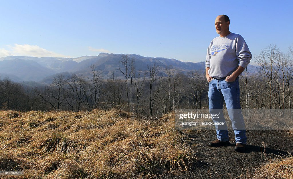 Frank Dixon stands on a ridge with Arch Coal strip mines in the background in Letcher County, Kentucky, Thursday, February 14, 2013. While Dixon and thousands of others in the United States have lost their jobs, coal is booming in the rest of the world.
