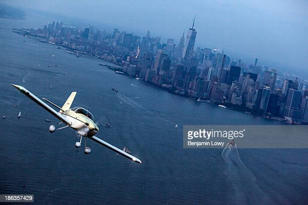 Frank Dombroski the founder of Flexwage and a flying enthusiast pilots his Single engine prop plane over the Hudson River on July 10 2013