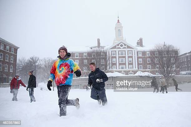 Frank DuBose a student at Harvard participates in a snow ball fight with friends on the Quad on the campus of Harvard University on January 27 2015...
